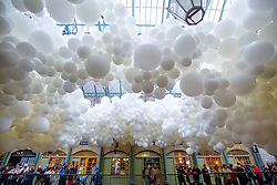 © Licensed to London News Pictures. 26/08/2015. London, UK. Covent Garden market hall is filled with 100,000 white balloons as part of an installation by French visual artist Charles Petillon on Wednesday, August 26, 2015. The work called 'Heartbeat' weaves its way through the South Hall of the Grade II listed market building and measures 54 metres long by 12 metres wide with 100,000 white balloons. Photo credit: Tolga Akmen/LNP