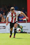 Brentford forward Scott Hogan (9)  dribbling during the EFL Sky Bet Championship match between Brentford and Ipswich Town at Griffin Park, London, England on 13 August 2016. Photo by Matthew Redman.