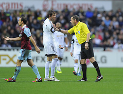 Referee  Phil Dowd  explains to Swansea City's Michu what hand ball is - Photo mandatory by-line: Joe Meredith/JMP - Tel: Mobile: 07966 386802 27/10/2013 - SPORT - FOOTBALL - Liberty Stadium - Swansea - Swansea City v West Ham United - Barclays Premier League