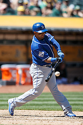 OAKLAND, CA - APRIL 17:  Christian Colon #24 of the Kansas City Royals hits a single against the Oakland Athletics during the fifth inning at the Oakland Coliseum on April 17, 2016 in Oakland, California.  The Oakland Athletics defeated the Kansas City Royals 3-2. (Photo by Jason O. Watson/Getty Images) *** Local Caption *** Christian Colon