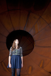 © Licensed to London News Pictures. 09/10/2012. LONDON, UK. A Lisson Gallery employee stands inside Anish Kapoor's sculpture 'Intersection' (2012) at a press view ahead of his new exhibition at the Lisson Gallery in London today (09/12/12) . The exhibition, the first since the artists solo exhibition at the Royal Academy of the Arts in 2009, features new works by Kapoor and runs from the 10th of October to the 10th of November 2012. Photo credit: Matt Cetti-Roberts/LNP