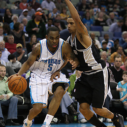 Mar 01, 2010; New Orleans, LA, USA; New Orleans Hornets guard Marcus Thornton (5) drives past San Antonio Spurs guard George Hill (3) during the second half at the New Orleans Arena. The Spurs defeated the Hornets 106-92. Mandatory Credit: Derick E. Hingle-US PRESSWIRE