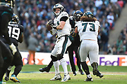 Philadelphia Eagles Carson Wentz QB (11) looks to throw the football during the International Series match between Jacksonville Jaguars and Philadelphia Eagles at Wembley Stadium, London, England on 28 October 2018.