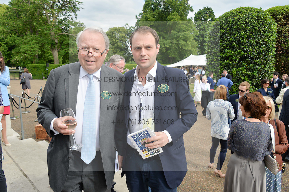 Left to right, EARL DE LA WARR and his son the HON.EDWARD SACKVILLE at Goffs London Sale held at The Orangery, Kensington Palace, London on 15th June 2015.
