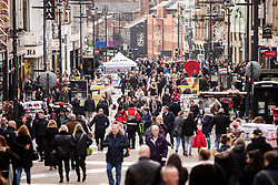 © Licensed to London News Pictures. 23/12/2017. Leeds UK. Picture shows Christmas shoppers on Briggate in Leeds city centre today. Photo credit: Andrew McCaren/LNP
