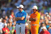 Rickie Fowler and Rory McIllroy wait to putt during their playoff at the Wells Fargo Championship at the Quail Hollow Club on May 6, 2012 in Charlotte, N.C. Fowler won in a three-way playoff with McIllroy and D.A. Points...©2012 Scott A. Miller.