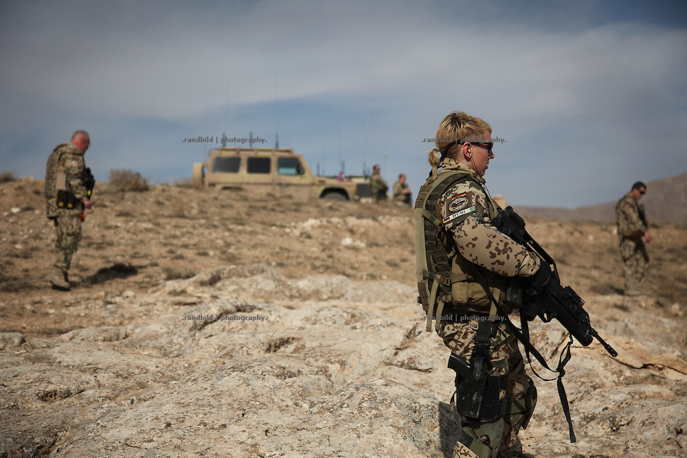 """A joint patrol of german military police and civil german police in the Marmal mountain range near Mazar-e Sharif. These """"show of forces"""" patrols are part of the """"Focused District Development""""-Programm which metors afghan police."""