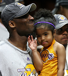 File photo dated june 14, 2009 of Los Angeles Lakers guard Kobe Bryant celebrates with his daughter following the Lakers' 99-86 defeat of the Orlando Magic in Game 5 of the NBA Finals at Amway Arena in Orlando, FL, USA. US basketball legend Kobe Bryant and his daughter Gianna are among nine people killed in a helicopter crash in the city of Calabasas, California. Bryant, 41, and Gianna, 13, were travelling in a private helicopter when it came down and burst into flames. Photo by Stephen M. Dowell/Orlando Sentinel/TNS/ABACAPRESS.COM