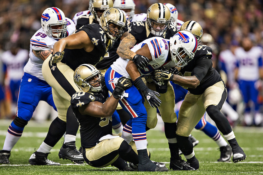 NEW ORLEANS, LA - OCTOBER 27:  Fred Jackson #22 of the Buffalo Bills is tackled by a gang of New Orleans Saints defenders at Mercedes-Benz Superdome on October 27, 2013 in New Orleans, Louisiana.  The Saints defeated the Bills 35-14.  (Photo by Wesley Hitt/Getty Images) *** Local Caption *** Fred Jackson