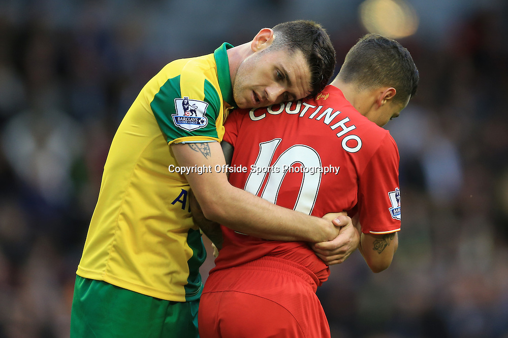 20th September 2015 - Barclays Premier League - Liverpool v Norwich City - Robbie Brady of Norwich hugs Philippe Coutinho of Liverpool - Photo: Simon Stacpoole / Offside.