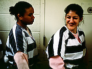 "01 NOVEMBER 1999  - PHOENIX, ARIZONA, USA: Members of the women chain gang in Maricopa County, Phoenix, AZ, joke around before they go out on the street to work. Maricopa county sheriff Joe Arpaio claims to have the only women's chain gang in the United States. He has been criticized for the chain gang but claims to be an ""equal opportunity incarcerator."" He has said that if puts men on a chain gang he will also put women on a chain gang. The women are prisoners in the county jail and volunteer for duty on the chain gang because it gets them out of the jail for six hours a day. The chain gang cleans up public streets, removes graffiti and buries the county's homeless and indigents.   © Jack Kurtz  WOMEN   PRISON   CIVIL RIGHTS  SOCIAL ISSUES    POVERTY"
