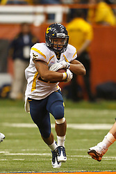 Oct 21, 2011; Syracuse NY, USA;  West Virginia Mountaineers running back Dustin Garrison (29) rushes up field against the Syracuse Orange during the fourth quarter at the Carrier Dome.  Syracuse defeated West Virginia 49-23. Mandatory Credit: Jason O. Watson-US PRESSWIRE