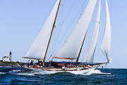 Adventuress racing in the Museum of Yachting Classic Yacht Regatta. Beavertail Lighthouse