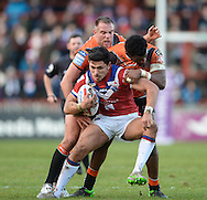 Mikey Sio of Wakefield Trinity Wildcats is tackled by Gadwin Springer and Andy Lynch of Castleford Tigers during the Pre-season Friendly match at Belle Vue, Wakefield<br /> Picture by Richard Land/Focus Images Ltd +44 7713 507003<br /> 15/01/2017
