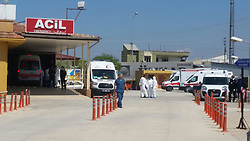 April 4, 2017 - Hatay, Hatay Province, Turkey - ACIL Emergency facility and ambulances wait for  victims of a supposed nerve gas attack (possibly the powerful and lethal sarin nerve gas) in north-western Syria. First reports place the death toll at 70 to 100, many childern. Several reported that airstrikes had targeted clinics treating the wounded. Khan Sheikhoun, Idhib Province is a rebel-held town of 165,000. Around 30 Turkish ambulances came to the border in Hatay Province, Turkey for medical evacuation of victims after the Syrian toxic gas attack, then to be brought to Turkish medical aid. (Credit Image: © Ferhat Dervisoglu/Depo Photos via ZUMA Wire)