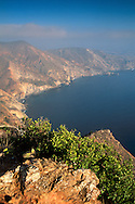 Steep rugged hills, coastal cliffs, and blue Pacific Ocean water, near Two Harbors, Catalina Island, California