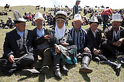Spectators at a traditional Kyrgyz horse games festival. Bosogo jailoo, Naryn province, Kyrgyzstan.