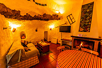 Living room of a Cave house (accomodations for tourists), Galera, Granada Province, Andalusia, Spain.
