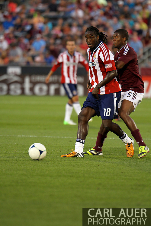 August 18th, 2012: Chivas USA midfielder Shalrie Joseph (18) protects the ball from Colorado Rapids midfielder Joseph Nane (5) in the first half at Dick's Sporting Goods Park