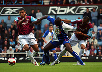Photo: Olly Greenwood.<br />West Ham United v Blackburn Rovers. The Barclays Premiership. 29/10/2006. Blackburn's Jason Roberts is surrounded by West Ham 's Hayden Mullins and Danny Gabbidon