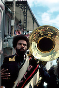 King leads a second line parade during a jazz funeral near the French Quarter of New Orleans, Louisiana; circa 1985