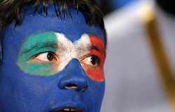 A fan of Italy with a painted face