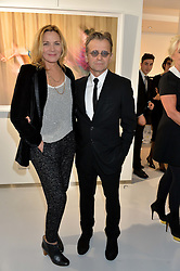 MIKHAIL BARYSHNIKOV and KIM CATTRALL at a private view of Dancing Away featuring work by Mikhail Baryshnikov held at ContiniArtUK, 105 New Bond Street, London on 27th November 2014.