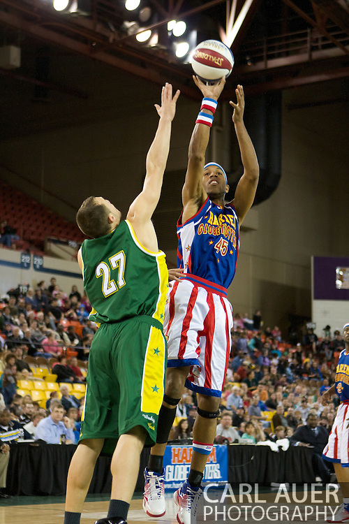 April 30th, 2010 - Anchorage, Alaska:  Moose (45) of the Harlem Globetrotters shows he can not only dunk, but can shoot, as he pulls up against the Washington Generals.