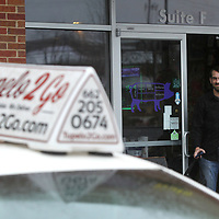Blake Richardson, a delivery driver for Tupelo 2 Go, walks out of Neon Pig with a customers lunch order. Next month, Tupelo 2 Go will celebrate its two-year anniversary. They have expanded their service to include the Mooreville and Saltillo areas and increased their delivery drivers from 4 to 30. Feburary will also be Richardson's two anniversary with the delivery business.