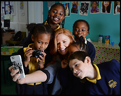 Eastenders actress Patsy Palmer has a selfie done as she joins pupils for breakfast on a visit to Laycock Primary School in Islington, London, to take part in London's Biggest Breakfast. Thursday, 22nd May 2014. Picture by Andrew Parsons / i-Images.<br /> <br /> Patsy Palmer goes back to school to host a hearty breakfast in support of 'London's Biggest Breakfast Campaign' <br /> <br /> The EastEnders Actress is having breakfast with children from Laycock Primary School Breakfast Club in Islington to raise money for London youth charity, the Mayor's Fund for London.