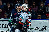 KELOWNA, BC - JANUARY 24: Kyle Topping #24 of the Kelowna Rockets shares a laugh on the ice with former teammate Conner Bruggen-Cate #20 of the Seattle Thunderbirds at Prospera Place on January 24, 2020 in Kelowna, Canada. (Photo by Marissa Baecker/Shoot the Breeze)