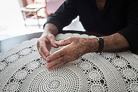ACCIAROLI (POLLICA), ITALY - 5 OCTOBER 2016: A detail of the hands of 94-years-old Giuseppe Vassallo is seen here as he sits in the living room of his house in Acciaroli, a hamlet in the municipality of Pollica, Italy, on October 5th 2016. Giuseppe Vassallo was an Italian Navy official during WWII. At age 86, 8 years ago, Mr Vassallo had multiple sex affairs to overcome his depression following his wife's death. He was a testimonial of the Acciaroli's mediterranean  diet and lifestyle during Expo 2015, the Universal Exposition hostel in Milan last year.<br /> <br /> To understand how people can live longer throughout the world, researchers at University of California, San Diego School of Medicine have teamed up with colleagues at University of Rome La Sapienza to study a group of 300 citizens, all over 100 years old, living in Acciaroli (Pollica), a remote Italian village nestled between the ocean and mountains in Cilento, southern Italy.<br /> <br /> About 1-in-60 of the area's inhabitants are older than 90, according to the researchers. Such a concentration rivals that of other so-called blue zones, like Sardinia and Okinawa, which have unusually large percentages of very old people. In the 2010 census, about 1-in-163 Americans were 90 or older.