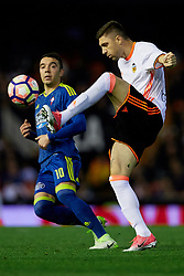April 6, 2017 - Valencia, Valencia, Spain - Guilherme Siqueira (R) of Valencia CF competes for the ball with Iago Aspas of Real Club Celta de Vigo during the La Liga match between Valencia CF and Real Club Celta de Vigo at Mestalla Stadium on April 6, 2017 in Valencia, Spain. (Credit Image: © David Aliaga/NurPhoto via ZUMA Press)