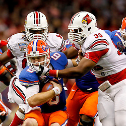 Jan 2, 2013; New Orleans, LA, USA; Louisville Cardinals defensive end Lorenzo Mauldin (94) and defensive end Sheldon Rankins (98) combine to sack Florida Gators quarterback Jeff Driskel (6) during the fourth quarter of the Sugar Bowl at the Mercedes-Benz Superdome. Louisville defeated Florida 33-23. Mandatory Credit: Derick E. Hingle-USA TODAY Sports