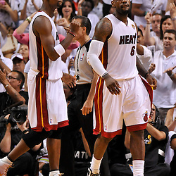 Jun 17, 2012; Miam, FL, USA; Miami Heat small forward LeBron James (6) and power forward Chris Bosh (1) during the second quarter in game three in the 2012 NBA Finals against the Oklahoma City Thunder at the American Airlines Arena. Mandatory Credit: Derick E. Hingle-US PRESSWIRE
