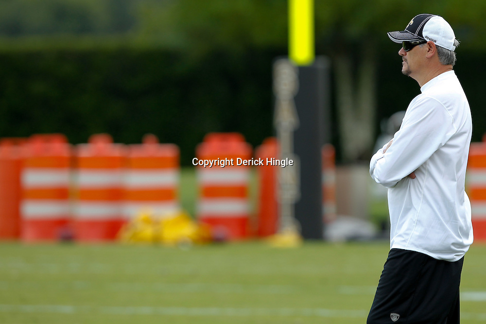 July 29, 2011; Metairie, LA, USA; New Orleans Saints general manager Mickey Loomis watches practice during the first day of training camp at the New Orleans Saints practice facility. Mandatory Credit: Derick E. Hingle