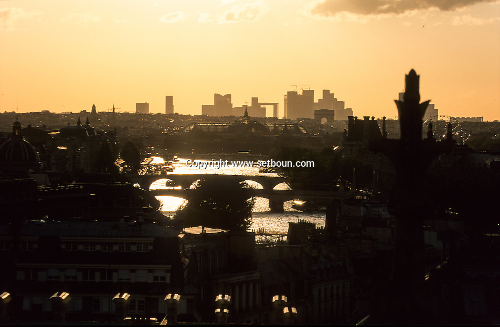 France. Paris; Elevated view on the Seine river and paris bridges. cityscape  and la Defense. view from the Sainte Chapelle