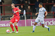 York City defender Keith Lowe & AFC Wimbledon forward Lyle Taylor   during the Sky Bet League 2 match between York City and AFC Wimbledon at Bootham Crescent, York, England on 24 October 2015. Photo by Simon Davies.