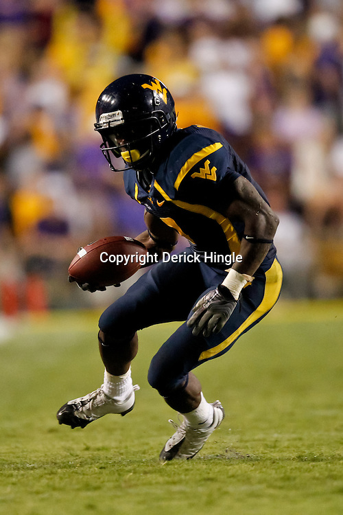Sep 25, 2010; Baton Rouge, LA, USA; West Virginia Mountaineers running back Noel Devine (7) runs with the ball against the LSU Tigers during the second half at Tiger Stadium. LSU defeated West Virginia 20-14.  Mandatory Credit: Derick E. Hingle