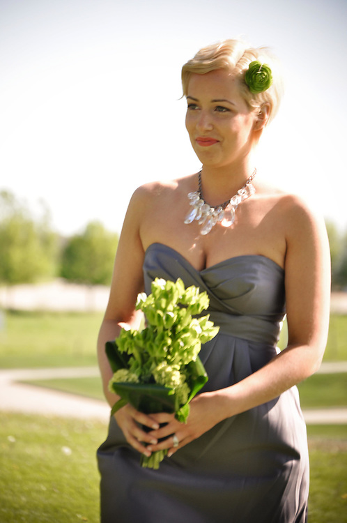 One of Abby's bridesmaids walks down the isle at Sticks, Des Moine, Iowa's