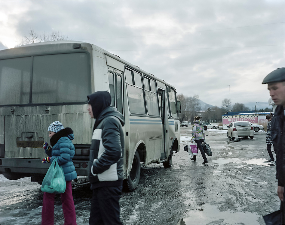 Passengers at the bus station on Saturday, October 26, 2013 in Baikalsk, Russia.