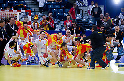 Kiril Lazarov of FYR Macedonia (C) and other players of FYR Macedonia celebrate  after the handball match between Slovenia and F.Y.R. Macedonia for 5th place at 10th EHF European Handball Championship Serbia 2012, on January 27, 2012 in Beogradska Arena, Belgrade, Serbia.  Macedonia defeated Slovenia 28-27.  (Photo By Vid Ponikvar / Sportida.com)