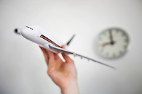 Close-up of hand holding model airplane
