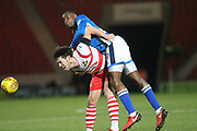 John Marquis is fouled by Donervan Daniels during the EFL Sky Bet League 1 match between Doncaster Rovers and Rochdale at the Keepmoat Stadium, Doncaster, England on 29 December 2017. Photo by Daniel Youngs.