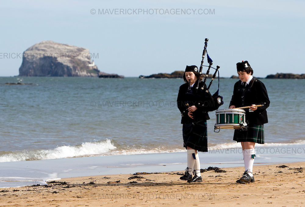 Niamh Davis 16 yrs and Cameron Hillhouse 13yrs practice on North Berwick beach before marching through the street. ..Bands from the Royal Scots Association of Pipe Bands perform at the final Tartan Week parade in East Lothian to celebrate the Homecoming Scotland initiative.....05/4/09.Michael Hughes/Maverick.Tel. 07789681770