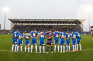 Colchester United players during a minute silence for the Terrorist attacks that occurred in Paris the night before during the Sky Bet League 1 match between Colchester United and Coventry City at the Weston Homes Community Stadium, Colchester<br />
