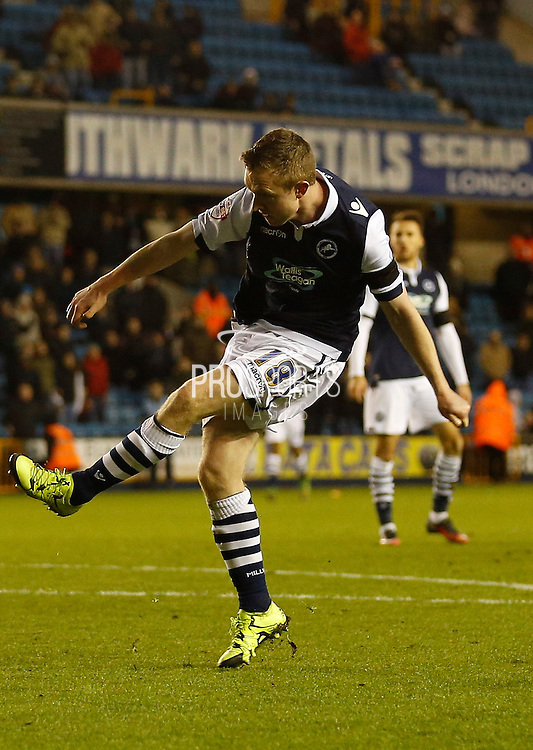 Millwall FC Midfielder Shane Ferguson scores his second of the game with a solid strike during the Sky Bet League 1 match between Millwall and Colchester United at The Den, London, England on 21 November 2015. Photo by Andy Walter.