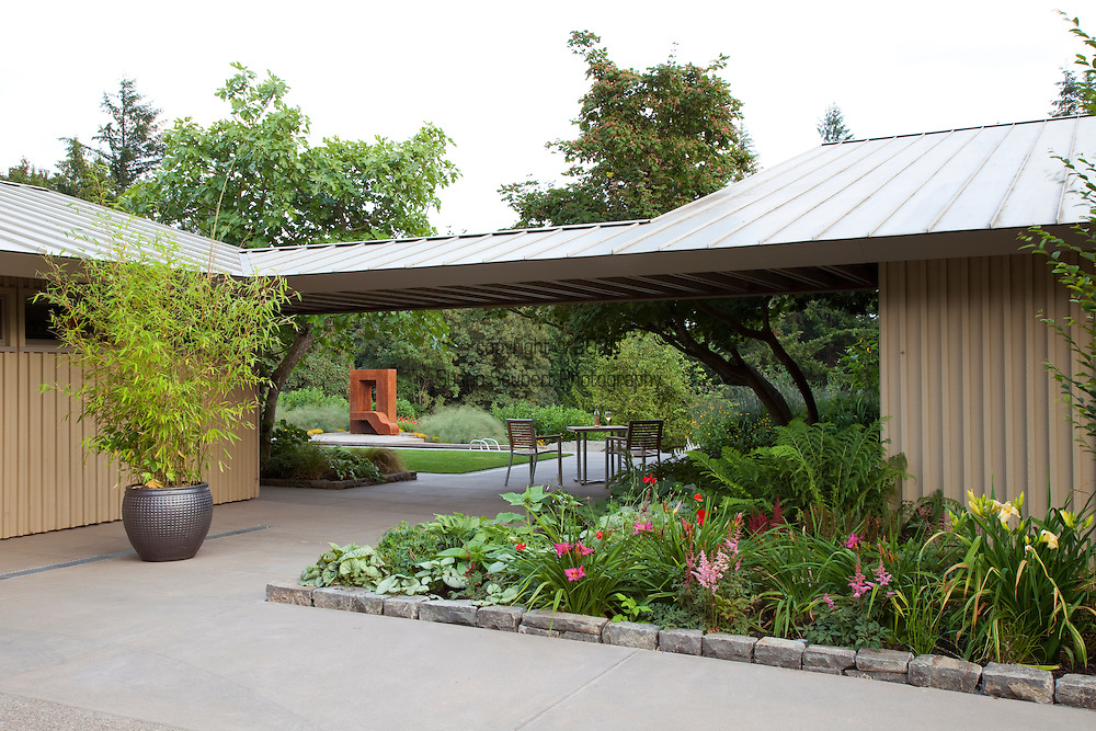 The front entrance of the house with planted beds