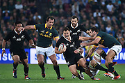 JOHANNESBURG, South Africa, 04 October 2014 : Israel Dagg of the All Blacks is tackled by Marcell Coetzee and Jan Serfontein (right) of the Springboks with Bismarck du Plessis (left) in support during the Castle Lager Rugby Championship test match between SOUTH AFRICA and NEW ZEALAND at ELLIS PARK in Johannesburg, South Africa on 04 October 2014. <br /> The Springboks won 27-25 but the All Blacks successfully defended the 2014 Championship trophy.<br /> <br /> © Anton de Villiers / SASPA