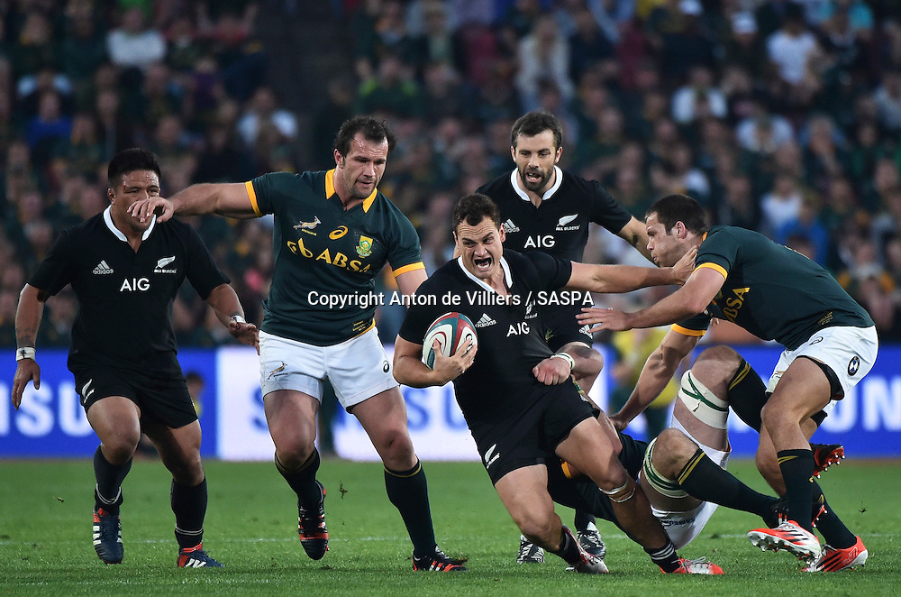 JOHANNESBURG, South Africa, 04 October 2014 : Israel Dagg of the All Blacks is tackled by Marcell Coetzee and Jan Serfontein (right) of the Springboks with Bismarck du Plessis (left) in support during the Castle Lager Rugby Championship test match between SOUTH AFRICA and NEW ZEALAND at ELLIS PARK in Johannesburg, South Africa on 04 October 2014. <br /> The Springboks won 27-25 but the All Blacks successfully defended the 2014 Championship trophy.<br /> <br /> &copy; Anton de Villiers / SASPA